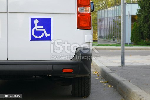 Minibus for disabled passengers with disability icons or signs on it
