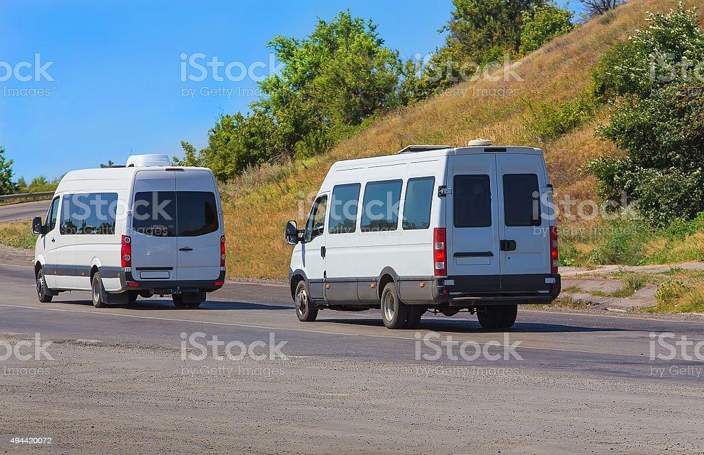 minibuses go on the twisting road stock photo