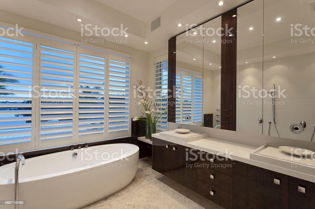 Minimaistic bathroom with a tub stock photo