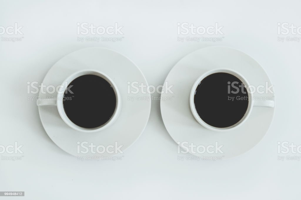 A minimal background of two cups of coffee stock photo