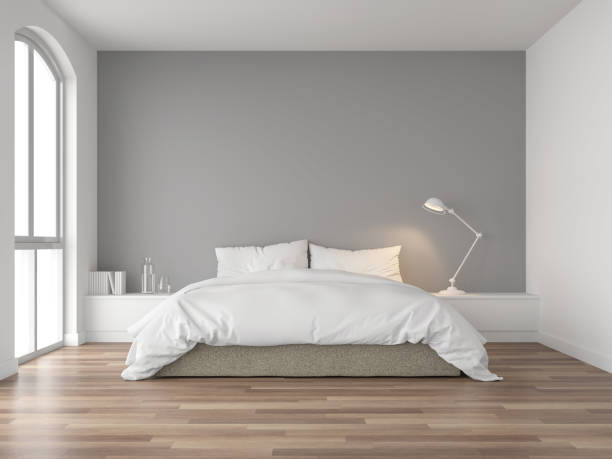 Minimal bedroom with gray wall 3d render Minimal bedroom 3d render,There are wood floor and  gray wall.Furnished with brown fabric bed and white blanket .There are arch shape window nature light shining into the room. bedroom stock pictures, royalty-free photos & images