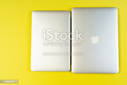 1202959798istockphoto Minimal Blank Laptop Yellow Background Flat Lay 1183956972