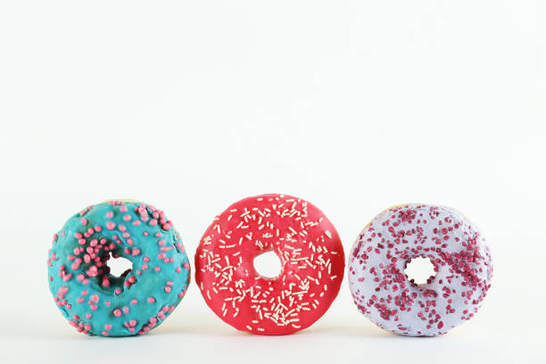 Minimal composition in vibrant colors with bright glaze donuts. stock photo