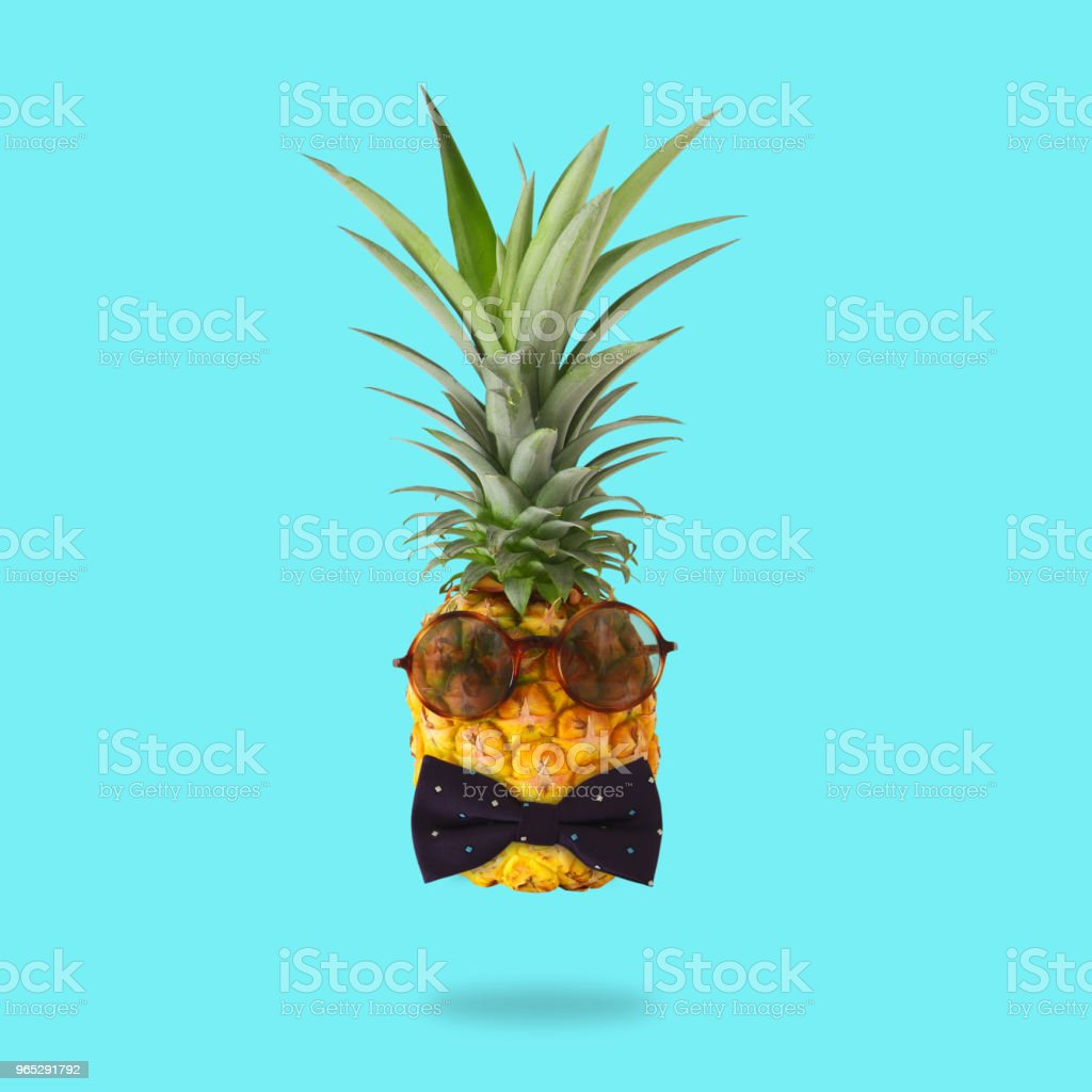 minimal concept. Cute and funny pineapple with sunglasses and bow tie over mint background. zbiór zdjęć royalty-free