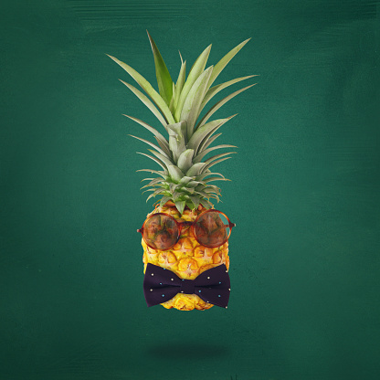 Minimal Concept Cute And Funny Pineapple With Sunglasses And Bow Tie Over Blackboard Background - zdjęcia stockowe i więcej obrazów Ananas