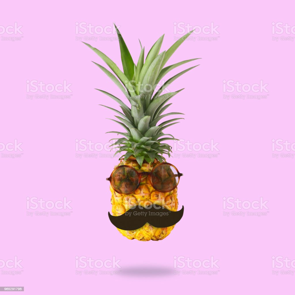 minimal concept. Cute and funny pineapple with sunglasses and mustache over pink background. zbiór zdjęć royalty-free