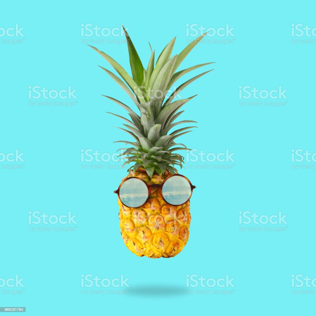 minimal concept. Cute and funny pineapple with sunglasses over mint background. zbiór zdjęć royalty-free