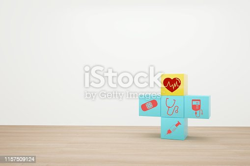 917079152istockphoto Minimal concept idea about of health and medical insurance, arranging block color stacking with icon healthcare medical on wooden background. 1157509124