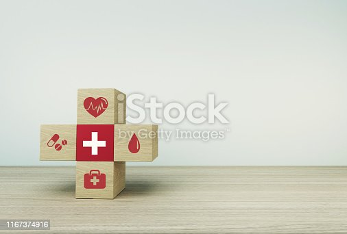 1029077176istockphoto Minimal concept idea about of health and medical insurance, arranging wood block stacking with icon healthcare medical on  table background. 1167374916