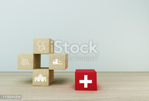 1029077176istockphoto Minimal concept idea about of health and medical insurance, arranging block color stacking with icon healthcare medical on wooden background. 1170241224