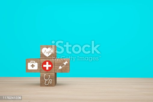 917079152istockphoto Minimal concept idea about of health and medical insurance, arranging wood block stacking with icon healthcare medical on wooden background. 1170241226