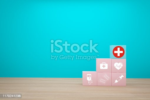 1029077176istockphoto Minimal concept idea about of health and medical insurance, arranging block color stacking with icon healthcare medical on wooden background. 1170241238