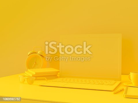 istock Minimal concept, Laptop on table Work desk yellow color 1063592752