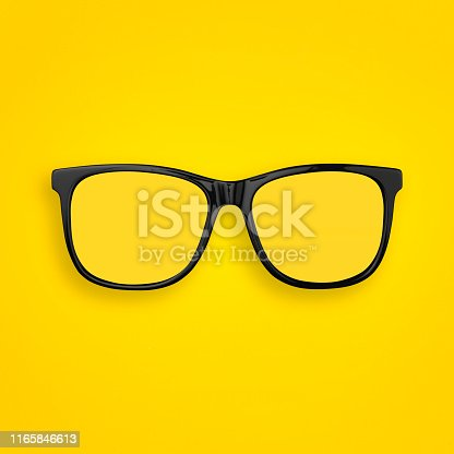 Minimal concept of  transparent glasses flat lay on pastel yellow, orange color paper background. Top view. Copy space.