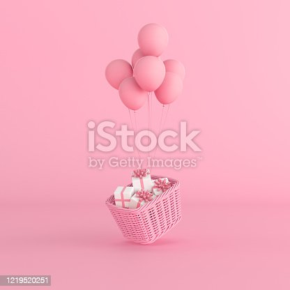 istock Minimal conceptual idea of present in the basket floating by pink balloons on pastel background. 3D rendering 1219520251
