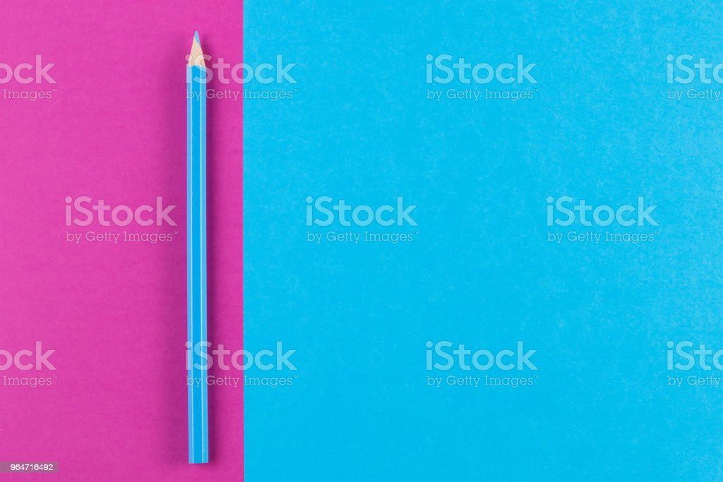 Minimal creative color papers geometry flat composition background with blue color pencil royalty-free stock photo