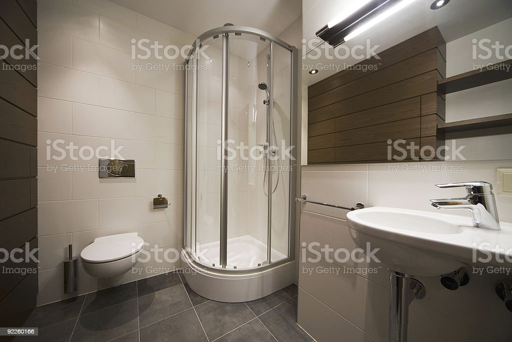 Minimal designed bathroom with wooden accents royalty-free stock photo