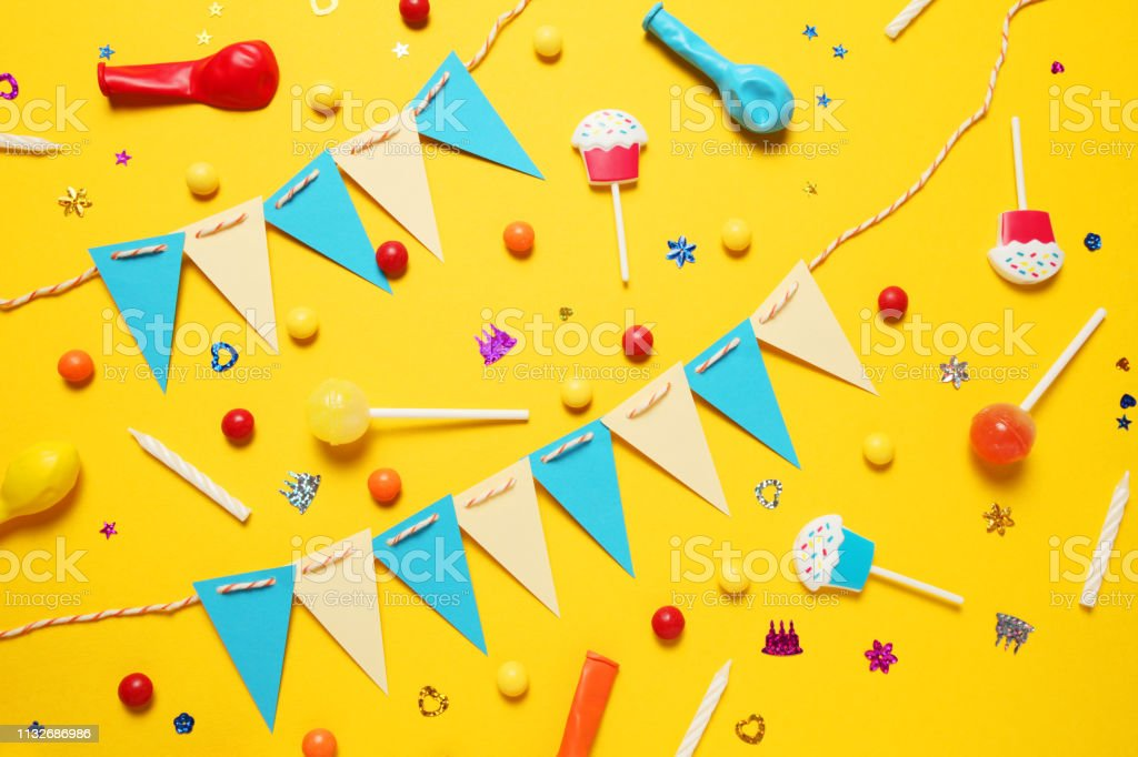 Minimal happy birthday decor for party. Sweet candy, balloons, straw.
