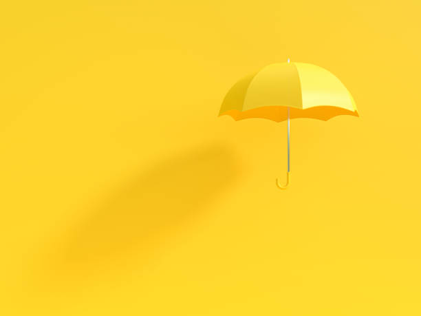 minimal idea concept. yellow umbrella with shadow on yellow background - chapéu imagens e fotografias de stock