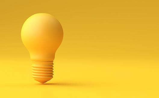 istock Minimal Idea Design Concept Yellow bulb on yellow pastel background. 896752278
