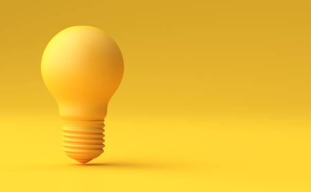 Minimal Idea Design Concept Yellow bulb on yellow pastel background. stock photo