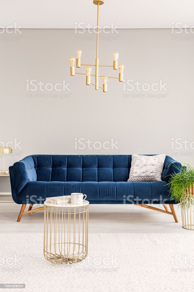 Picture of: Minimal Living Room Interior With A Dark Blue Sofa And Gold Metal Chandelier And A Coffee Table Empty Copy Space Wall Real Photo Stock Photo Download Image Now Istock