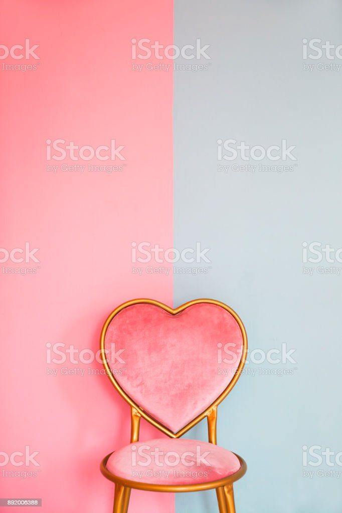 Minimal of Pink background with heart chair stock photo