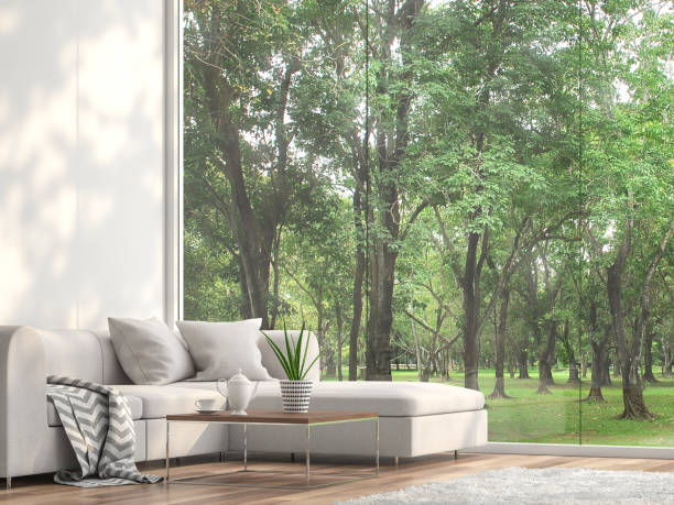 minimale sofa befindet sich am fenster mit blick auf den garten 3d render - vorgarten landschaftsbau stock-fotos und bilder