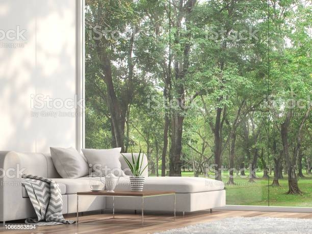Photo of Minimal sofa located at the window with garden view 3d render