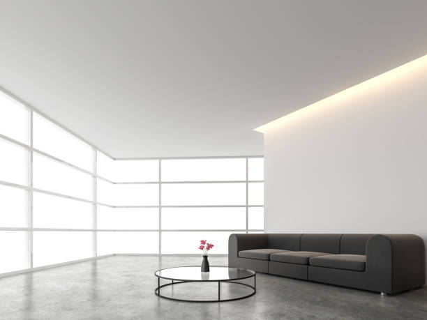 Minimal style living room with white backdrop 3d render Minimal style living room with white backdrop 3d render.There are concrete floor,white wall.Finished with dark gray sofa,The room has large windows. Looking out to see the scenery outside. lustrous concrete floor stock pictures, royalty-free photos & images