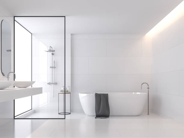 Minimal style white bathroom 3d render Minimal style white bathroom 3d render, There are large white tile wall and floor.There have glass partition for shower zone,The room has large windows.Natural light transmitted through the room. bathroom stock pictures, royalty-free photos & images