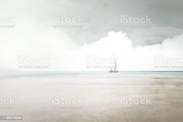 Photo of minimal surreal landscape, sail boat navigate on the sea