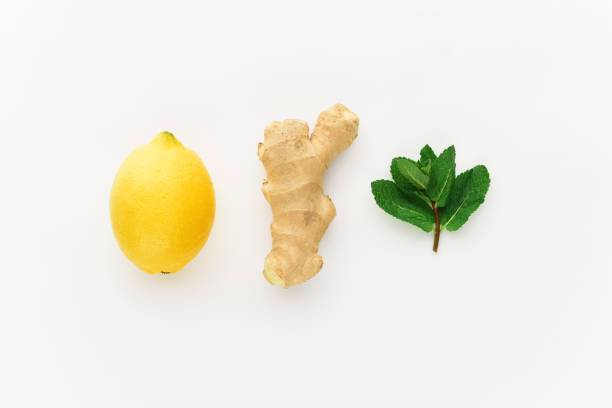 minimalism lemon and ginger on a white background. concept of increasing immunity in winter - ginger stock photos and pictures
