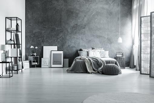 istock Minimalist and gray loft bedroom 830503912