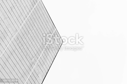 istock Minimalist architecture pointing into the sky with geommetrical lines in black and white 1031523078