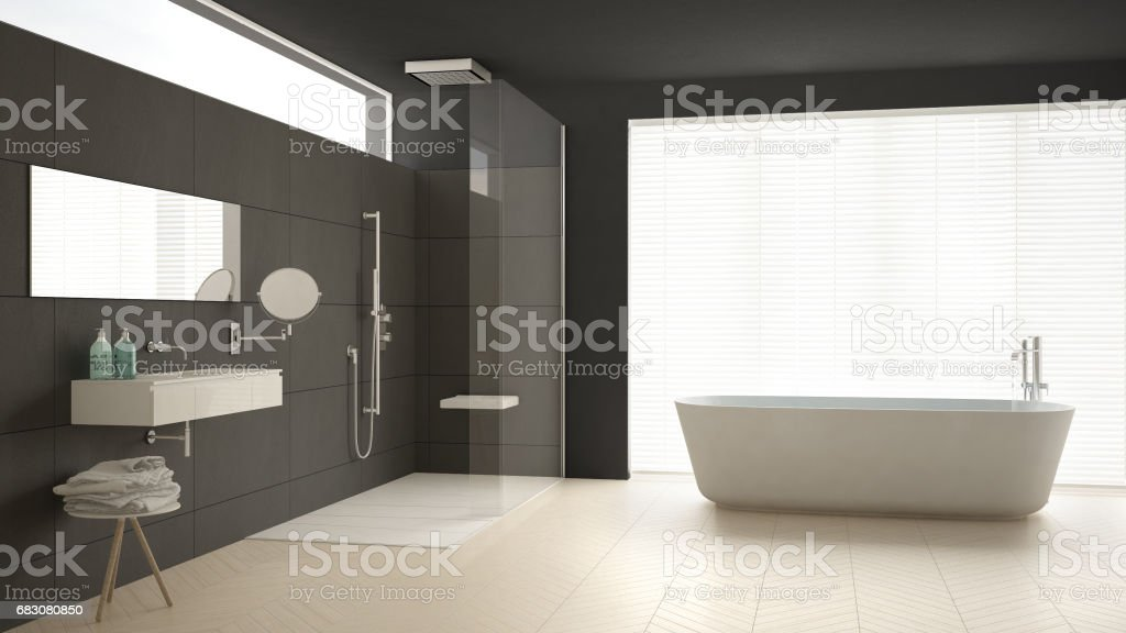 Minimalist bathroom with bathtub and shower, parquet floor and marble tiles, classic gray interior design foto de stock royalty-free