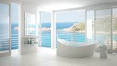 Minimalist bathroom with big bath tub and panoramic window, italian interior design, Sardinia, Santa Teresa Gallura