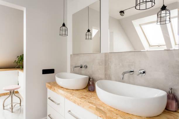 minimalist bathroom with two sinks - badarmaturen stock-fotos und bilder