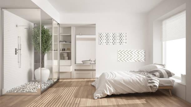 minimalist bedroom and bathroom with shower and walk-in closet, classic scandinavian interior design - badewannenkissen stock-fotos und bilder