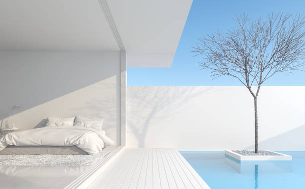 Minimalist bedroom In a private residence 3d render stock photo