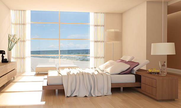 minimalist bedroom interior with sea view - hotelzimmer stock-fotos und bilder