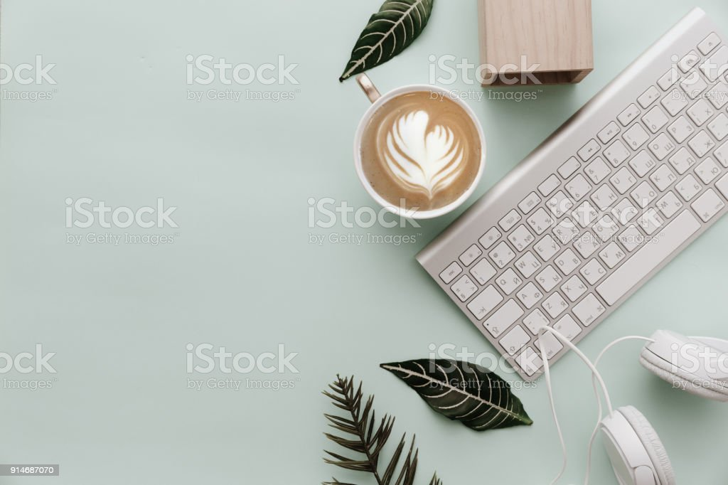Minimalist Flat Lay Hipster Desktop With Coffee and Keyboard