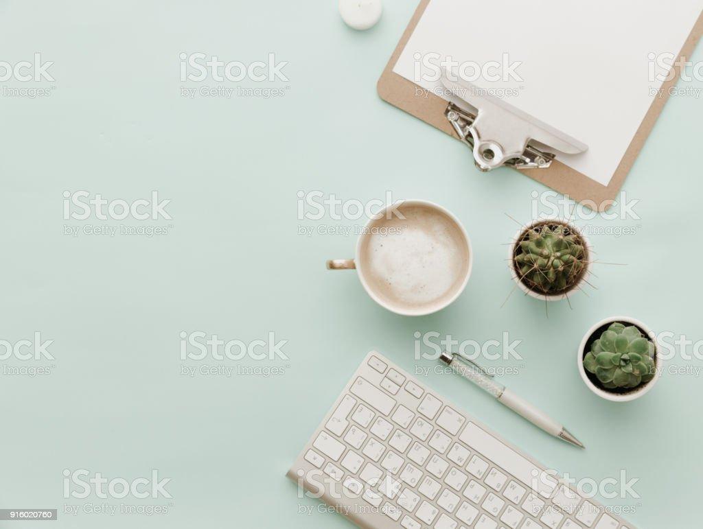 Minimalist Flat Lay Hipster Desktop With coffee latte, keyboard,...
