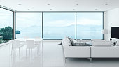 Modern luxury living room interior with beautiful sea view.