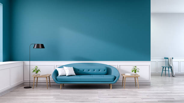 Minimalist interior of living room, blue sofa with wood table and black lamp on wood flooring and deep sky blue wall  ,3d rendering stock photo