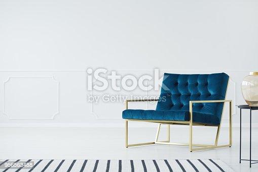 istock Minimalist interior with blue armchair 956563488