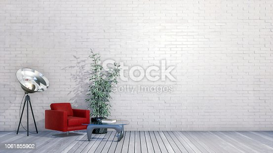 Modern minimalist interior of loft or creative studio with red armchair, small table and spotlight lamp against empty white brick wall with copy space. 3D illustration from my own 3D rendering file.