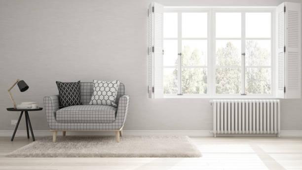 Minimalist living room, simple white living with big window, scandinavian classic interior design stock photo