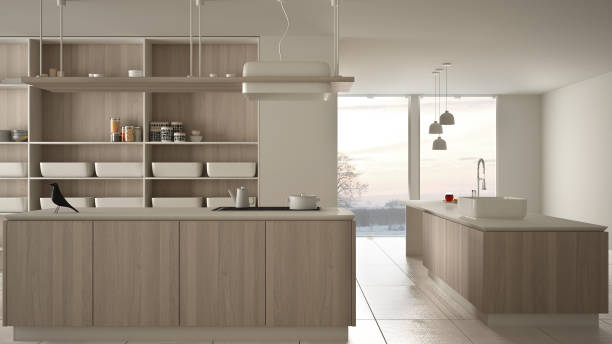 Minimalist luxury expensive white and wooden kitchen, island, sink and gas hob, open space, panoramic window, marble ceramic floor, modern interior design architecture concept idea stock photo