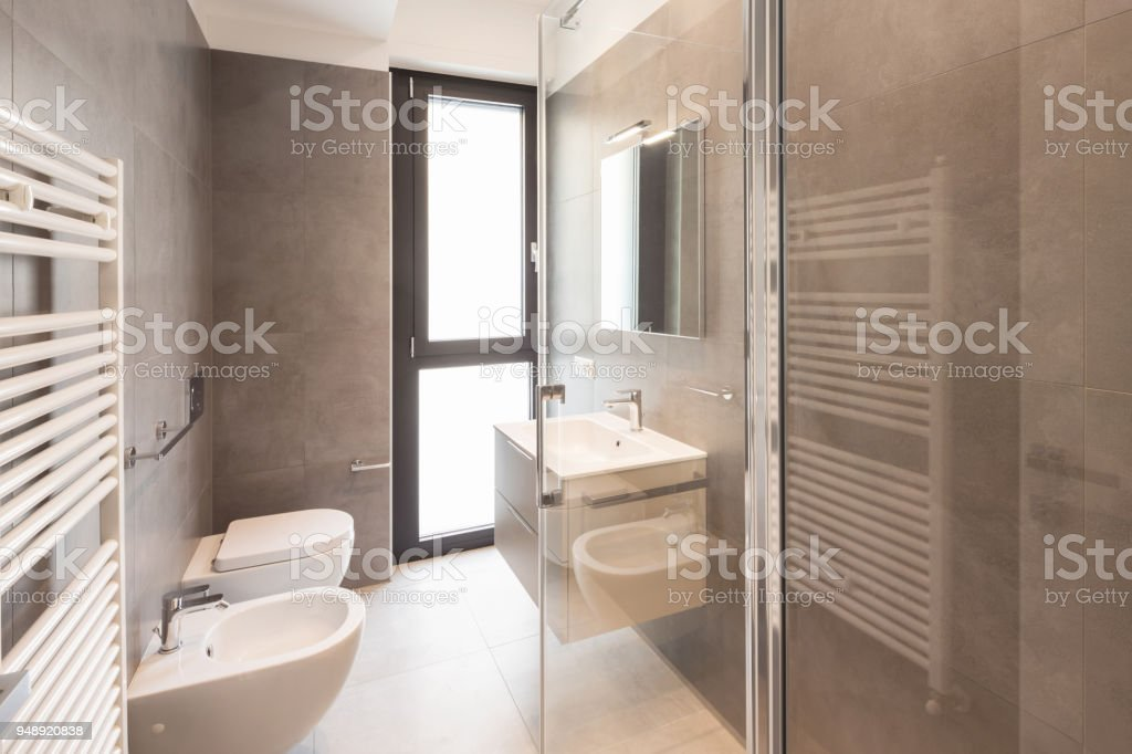 Minimalist modern bathroom with large tiles stock photo